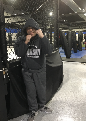 Timmy dressed in athletic gear at the Mixed Martial Arts gym
