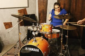 Aurea enjoying playing the drums